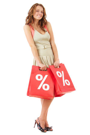 Portrait of a girl holding handbags with discount symbol Stock Photo - 9571979