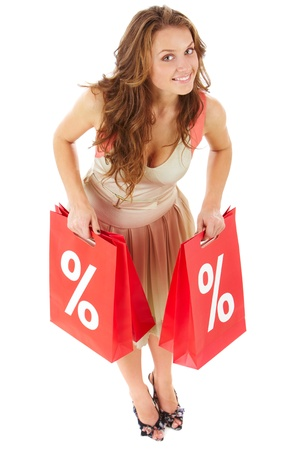 Portrait of a girl holding handbags with discount symbol Stock Photo - 9571982