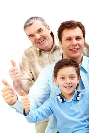 Portrait of a man, older man and boy showing big thumb photo