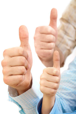 Close-up of three big thumbs photo