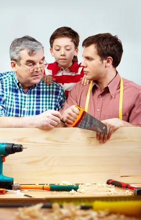 Family of men working with diy tools photo