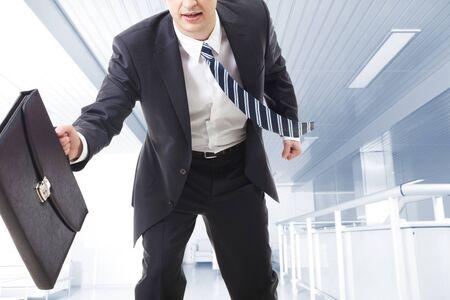 Close-up of running businessman photo