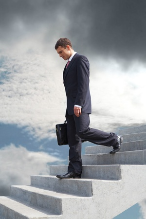 fiasco: Image of sad businessman walking downstairs