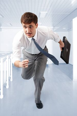 running businessman: A businessman running in office building Stock Photo