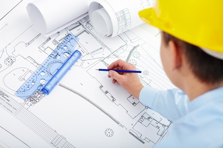 Male hand sketching housing project Stock Photo - 9572201