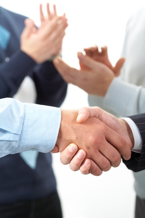 Two shaking hands against applauding hands  photo