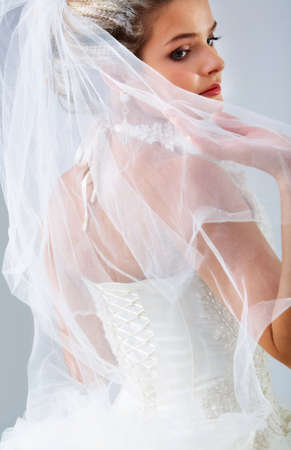 wedding veil: Portrait of pretty bride posing in isolation  Stock Photo