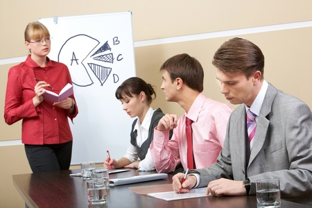 Image of smart teacher looking at businessman and speaking to him in workshop Stock Photo - 9634016