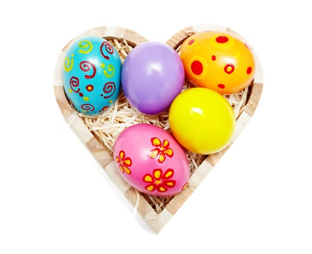 Heart shaped box full of colorful Easter eggs photo