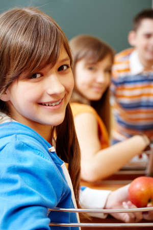 Confident student looking at camera during lesson Stock Photo - 9634022