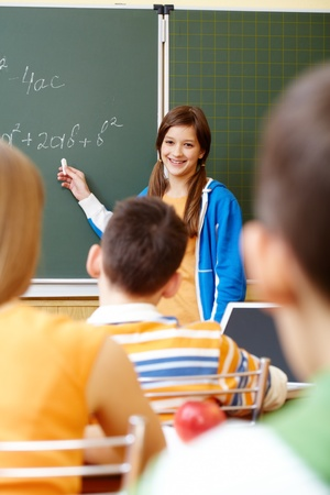 Confident student looking at camera in classroom Stock Photo - 9634019