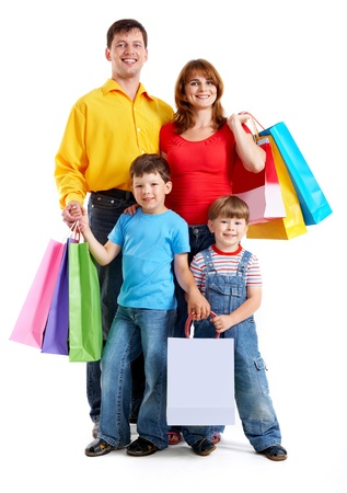Photo of friendly parents and siblings with bags isolated over white background photo