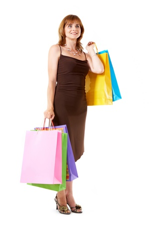 Happy shopper holding colorful paper bags Stock Photo - 9633231