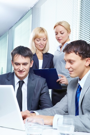 Four business people working in office Stock Photo - 9634047
