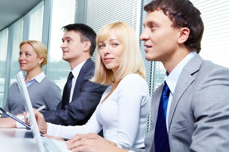 Four business people working at conference Stock Photo - 9634024