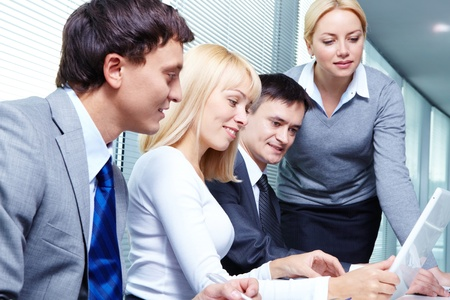 Four business people working at meeting Stock Photo - 9634592