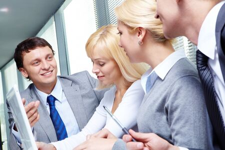 Four business people working at meeting Stock Photo - 9633393