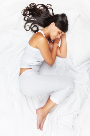 pillow sleep: Portrait of a young girl sleeping in white pajamas  Stock Photo