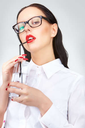 Gorgeous woman with glass of water looking at camera photo