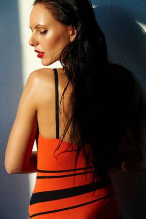 monokini: Elegant woman looking aside Stock Photo