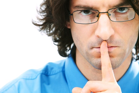 Portrait of serious businessman with glasses touching mouth photo