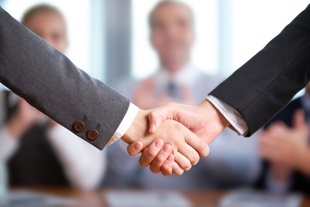 negotiation business: Photo of handshake of business partners after striking deal