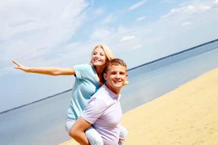 Portrait of happy couple by the seaside Stock Photo - 9633585