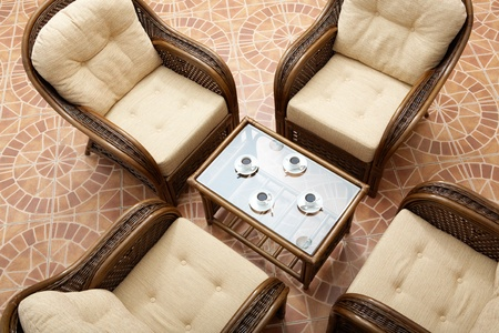 Above view of glass table surrounded by four brown arm chairs Stock Photo - 9634997