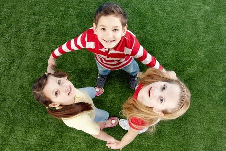 Image of happy friends on the grass looking at camera  Stock Photo - 9633893