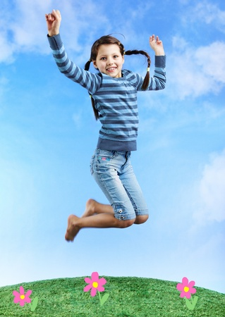 children jumping: Image of happy girl jumping on the grass Stock Photo