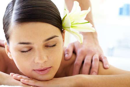 Portrait of calm female during luxurious procedure of massage photo