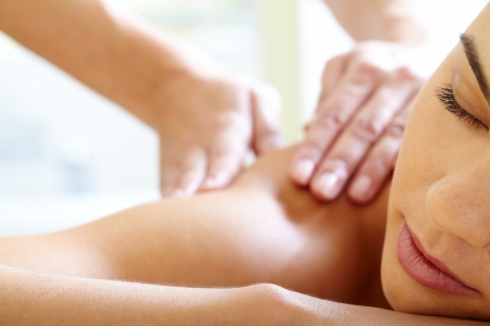massage face: Part of face of calm female during luxurious procedure of massage