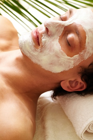 Young man having pore cleaning procedure in parlor Stock Photo - 9634289