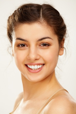 Portrait of charming woman looking at camera with smile photo