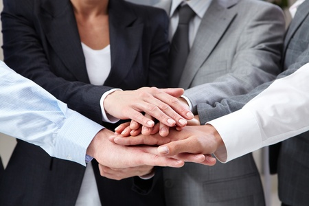 altogether: Image of business people hands on top of each other symbolizing support and power