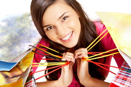 Portrait of happy girl with colorful paper bags looking at camera with smile Stock Photo - 9634398