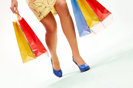 Legs of lady with colorful paper bags in move Stock Photo - 9633952