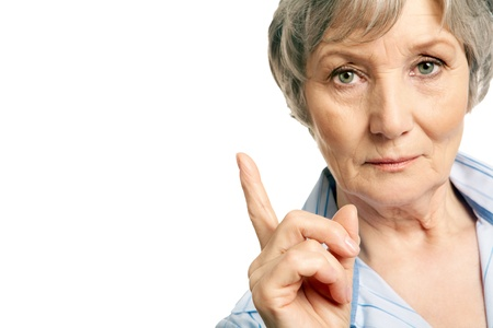 congenial: Photo of elderly female with her forefinger pointed upwards on white background Stock Photo
