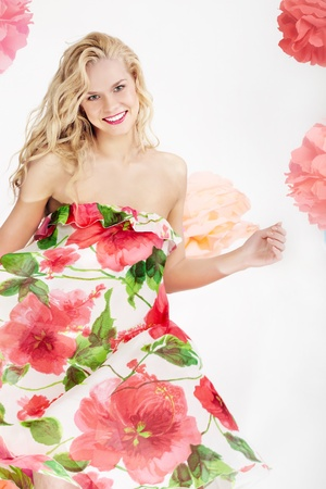 Happy woman in glamorous dress with floral print looking at camera Stock Photo - 9675419