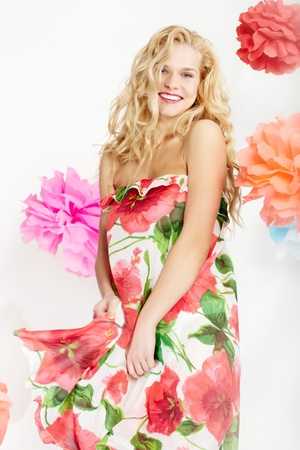 Happy woman in glamorous dress with floral print looking at camera Stock Photo - 9675420