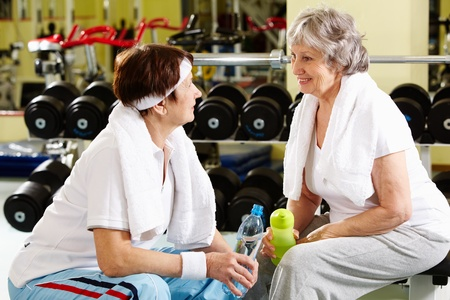 Portrait of senior females refreshing after workout in gym Stock Photo - 9675404