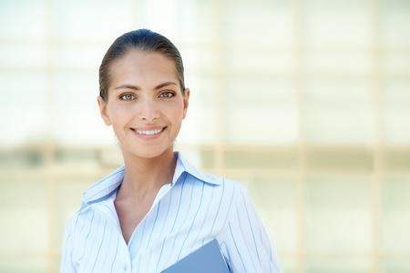 Portrait of pretty employee smiling at camera photo