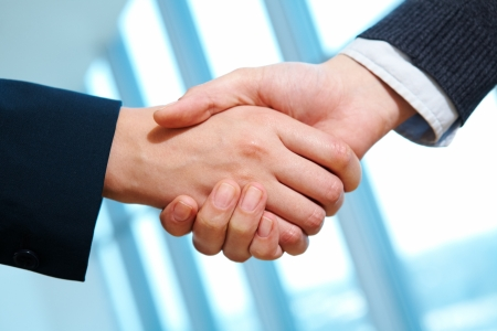 business deal: Photo of handshake of business partners after striking deal