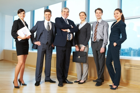 Portrait of confident business group standing in row and looking at camera Stock Photo - 9675275