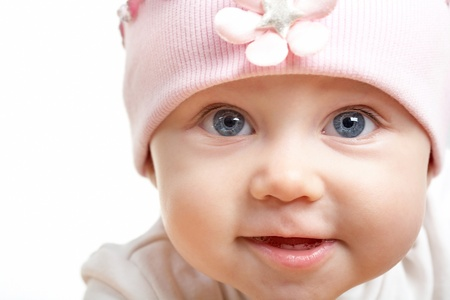innocent: Face of adorable baby in hat looking at camera