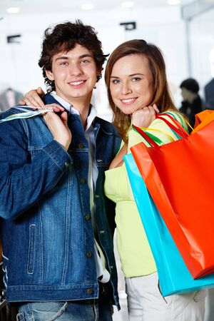 Portrait of loving couple after buying gifts looking at camera with smiles Stock Photo - 9725174