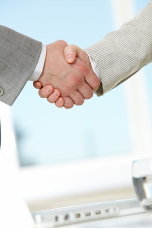 Photo of handshake of business partners after making agreement Stock Photo - 9725176