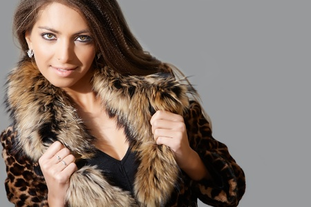 Portrait of sexy female in fashionable coat posing during photoshoot Stock Photo - 9725159