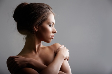 photoshoot: Portrait of elegant female with her arms crossed on chest Stock Photo