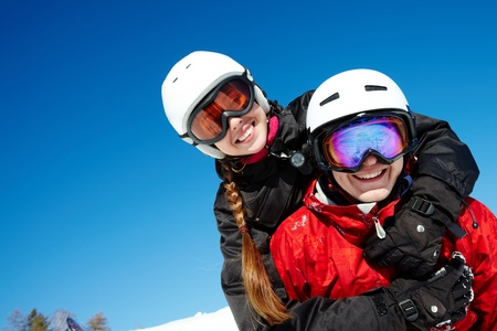 Portrait of happy couple of snowboarders outside during winter vacations photo